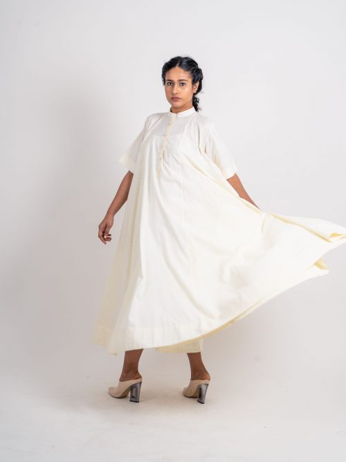 PLAIN AND TEXTURED GODET DRESS WITH SLEEVE